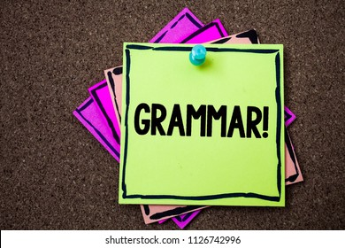 Writing note showing  Grammar Motivational Call. Business photo showcasing System and Structure of a Language Writing Rules Papers ideas messages to do lists cork background remember important.