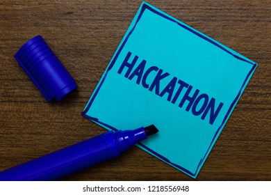Writing note showing Hackathon. Business photo showcasing event where large number of showing engage in programming Blue Paper Important reminder Communicate ideas Wooden background.