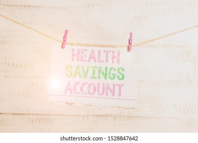 Writing note showing Health Savings Account. Business photo showcasing users with High Deductible Health Insurance Policy Clothesline clothespin rectangle shaped paper reminder white wood desk.