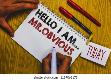 Writing note showing Hello I Am.. Mr.Obvious. Business photo showcasing introducing yourself as pouplar or famous person Man holding marker notebook clothepin reminder wooden table cup coffee.