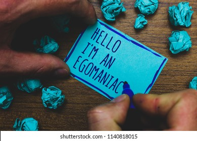 Writing note showing Hello I am An Egomaniac. Business photo showcasing Selfish Egocentric Narcissist Self-centered Ego Foggy hand hold marker drawn blue notepad paper lump on wooden floor.