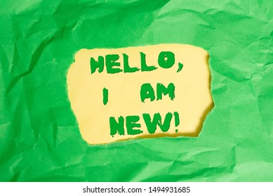 Writing note showing Hello I Am New. Business photo showcasing used as greeting or to begin telephone conversation Green crumpled colored paper sheet torn colorful background.