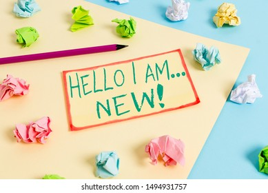 Writing note showing Hello I Am New. Business photo showcasing used as greeting or to begin telephone conversation Colored crumpled papers empty reminder blue yellow clothespin.