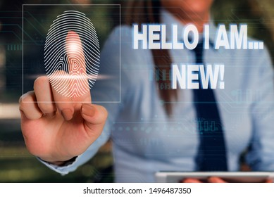 Writing note showing Hello I Am New. Business photo showcasing used as greeting or to begin telephone conversation Woman wear formal work suit presenting presentation using smart device.