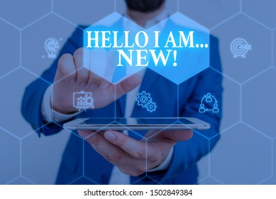 Writing note showing Hello I Am New. Business photo showcasing used as greeting or to begin telephone conversation Male wear formal work suit presenting presentation smart device.