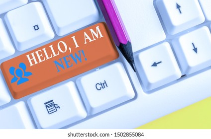 Writing note showing Hello I Am New. Business photo showcasing used as greeting or to begin telephone conversation White pc keyboard with note paper above the white background.