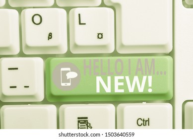 Writing note showing Hello I Am New. Business photo showcasing used as greeting or to begin telephone conversation Keyboard with note paper on white background key copy space.