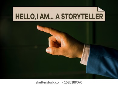 Writing note showing Hello I Am A Storyteller. Business photo showcasing introducing yourself as novels article writer Isolated hand pointing with finger. Business concept pointing finger.