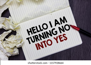 Writing note showing Hello I Am Turning No Into Yes. Business photo showcasing Persuasive Changing negative into positive Marker over notebook crumpled papers pages several tries mistakes.