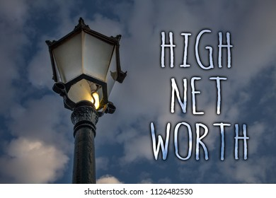 Writing note showing  High Net Worth. Business photo showcasing having high-value Something expensive A-class company Light post cloudy enlighten message reflection thoughts intentions.