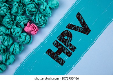 Writing note showing  Hpv. Business photo showcasing Human Papillomavirus Infection Sexually Transmitted Disease Illness written Painted background Crumpled Paper Balls next to it.