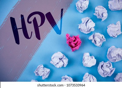 Writing note showing  Hpv. Business photo showcasing Human Papillomavirus Infection Sexually Transmitted Disease Illness written on Painted background Crumpled Paper Balls next to it.