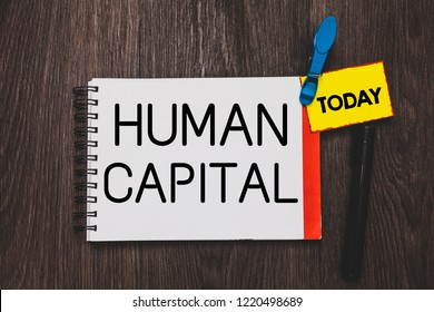 Writing note showing Human Capital. Business photo showcasing Intangible Collective Resources Competence Capital Education Open notebook white page clothespin holding reminder wooden background.