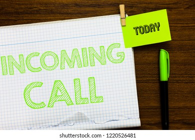 Writing note showing Incoming Call. Business photo showcasing Inbound Received Caller ID Telephone Voicemail Vidcall Open notebook page markers holding paper heart wooden background.