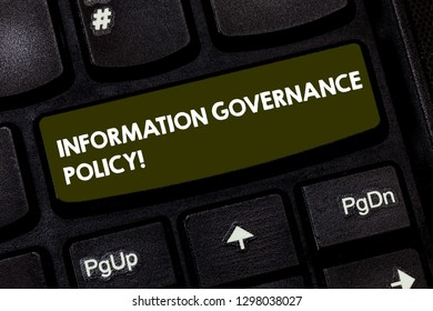 Writing note showing Information Governance Policy. Business photo showcasing Standards or metrics in handling information Keyboard key Intention to create computer message pressing keypad idea.