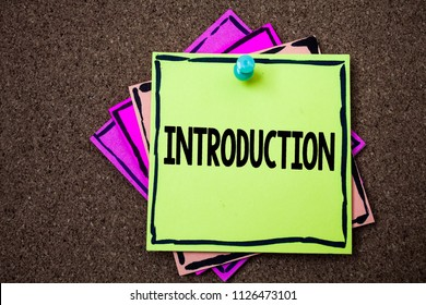 Writing note showing  Introduction. Business photo showcasing First part of a document Formal presentation to an audience Papers ideas messages to do lists cork background remember important.