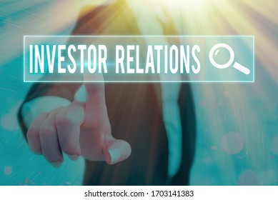 Writing note showing Investor Relations. Business photo showcasing management responsibility that integrates finance.