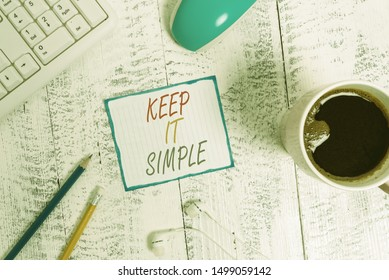 Writing note showing Keep It Simple. Business photo showcasing to make something easy to understand and not in fancy way Technological devices colored reminder paper office supplies.