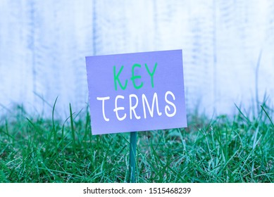 Writing note showing Key Terms. Business photo showcasing Words that can help a demonstrating in searching information they need Plain paper attached to stick and placed in the grassy land.