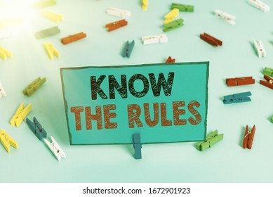 Writing note showing Know The Rules. Business photo showcasing set explicit or regulation principles governing conduct Colored clothespin papers empty reminder blue floor officepin.