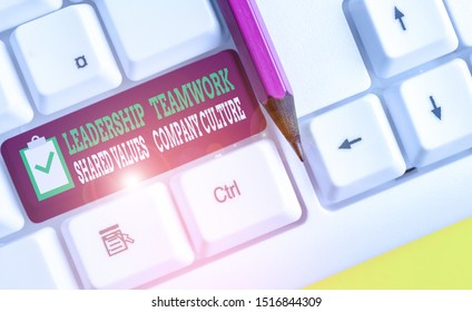 Writing note showing Leadership Teamwork Shared Values Company Culture. Business photo showcasing Group Team Success White pc keyboard with note paper above the white background.