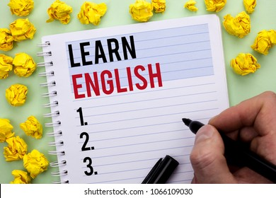 Writing note showing  Learn English. Business photo showcasing Study another Language Learn Something Foreign Communication written By Man Holding Marker on Notebook Book.