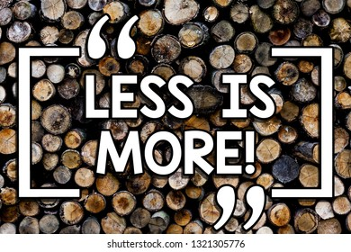 Writing note showing Less Is More. Business photo showcasing Minimalist approach to artistic matter is more effective Wooden background vintage wood wild message ideas intentions thoughts.