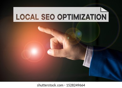 Writing note showing Local Seo Optimization. Business photo showcasing increase Search Visibility to Rank on Top list Isolated hand pointing with finger. Business concept pointing finger.