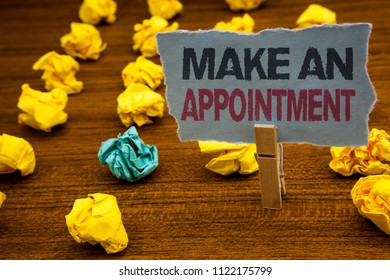 Writing note showing  Make An Appointment. Business photo showcasing Schedule Arrangement Deadline Session Engagement Cardboard with letters wooden floor fuzzy yellow lumps green hunch.