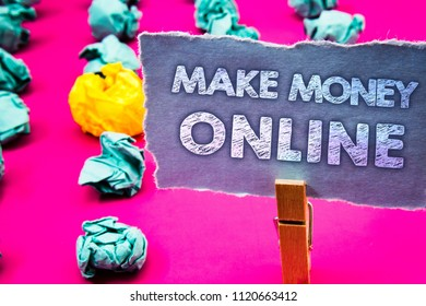 Writing note showing  Make Money Online. Business photo showcasing Business Ecommerce Ebusiness Innovation Web Technology Words torn paper wooden clip pink background crumbled yellow blue note.