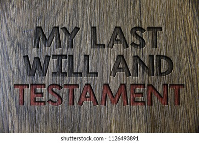 Writing note showing  My Last Will And Testament. Business photo showcasing List of things to be made after his or her death Wooden wood background black engraved letters ideas messages concepts.