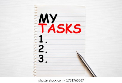 Writing note showing My Tasks. Business photo showcasing assigned piece of work often to be finished within a certain time Cardboard which is torn placed above a wooden classic table.