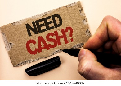 Writing note showing  Need Cash Question. Business photo showcasing Wealth Question Needy Currency Money Advice Conceptual written by Man Holding Marker on tear Cardboard Piece Plain Background.