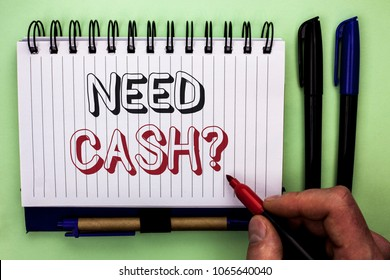 Writing note showing  Need Cash Question. Business photo showcasing Wealth Question Needy Currency Money Advice Conceptual written by Man Holding Marker on Nootbook Book plain background Marker.