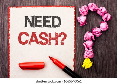 Writing note showing  Need Cash Question. Business photo showcasing Wealth Question Needy Currency Money Advice Conceptual written on Cardboard Piece With Marker wooden background Question Mark.