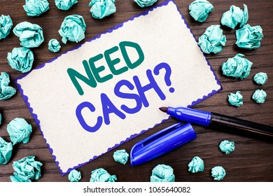 Writing note showing  Need Cash Question. Business photo showcasing Wealth Question Needy Currency Money Advice Conceptual written on Cardboard Piece on the wooden background Marker next to it.