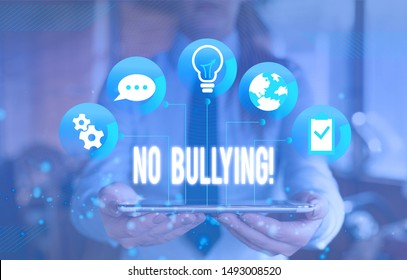 Writing note showing No Bullying. Business photo showcasing stop aggressive behavior among children power imbalance Female human wear formal work suit presenting smart device.