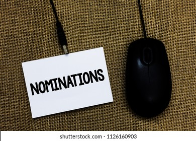 Writing note showing Nominations. Business photo showcasing Suggestions of someone or something for a job position or prize Sticky card type text convey message computer mouse jute background.