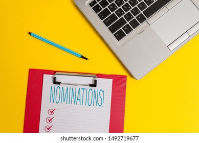 Writing note showing Nominations. Business photo showcasing action of nominating or state being nominated for prize Trendy metallic laptop clipboard paper sheet marker colored background.