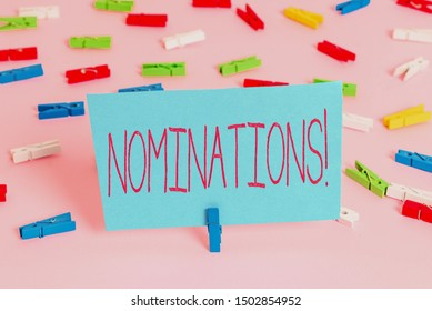Writing note showing Nominations. Business photo showcasing action of nominating or state being nominated for prize Colored clothespin papers empty reminder pink floor office pin.