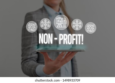 Writing note showing NonProfit. Business photo showcasing not making or conducted primarily to make profit organization Woman wear formal work suit presenting presentation using smart device.