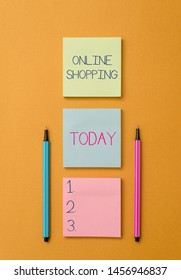 Writing note showing Online Shopping. Business photo showcasing allows consumers to buy their goods over the Internet Front view colored sticky note two ballpoints cool yolk background.