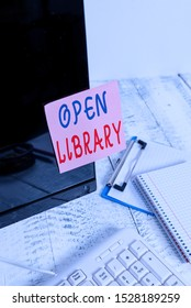 Writing note showing Open Library. Business photo showcasing online access to analysisy public domain and outofprint books Note paper taped to black computer screen near keyboard and stationary.