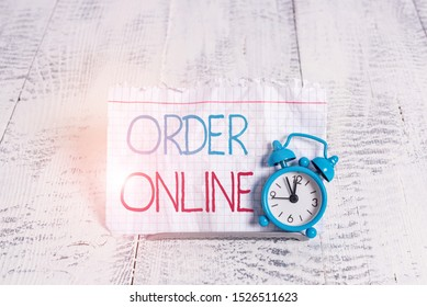 Writing note showing Order Online. Business photo showcasing activity of buying products or services over the Internet.