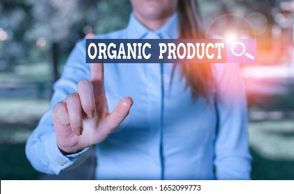 Writing note showing Organic Product. Business photo showcasing made from materials produced by organic agriculture Woman in a blue shirt pointing with her finger into empty space.