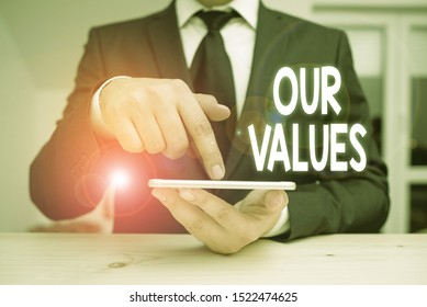 Writing note showing Our Values. Business photo showcasing list of morals companies or individuals commit to do them.