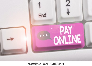 Writing note showing Pay Online. Business photo showcasing buy products or service using credit card on any website White pc keyboard with note paper above the white background.