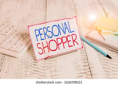 Writing note showing Personal Shopper. Business photo showcasing individual who is paid to help another to purchase goods Notepaper on wire in between computer keyboard and sheets.