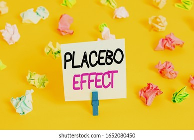 Writing note showing Placebo Effect. Business photo showcasing a beneficial effect produced by a placebo drug or treatment Colored crumpled paper empty reminder white floor clothespin.