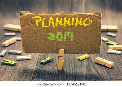 Writing note showing Planning 2019. Business photo showcasing Begin with end in the Mind Positioning Long term Objectives Clothespin holding paperboard important communicating message ideas.